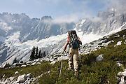 Jim Prager traverses Luna Cirque, a dramatic basin below the rugged Northern Picket Range, North Cascades National Park, Washington.