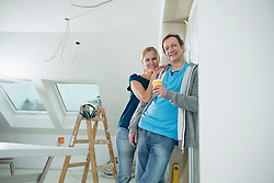 Couple at construction site of new building