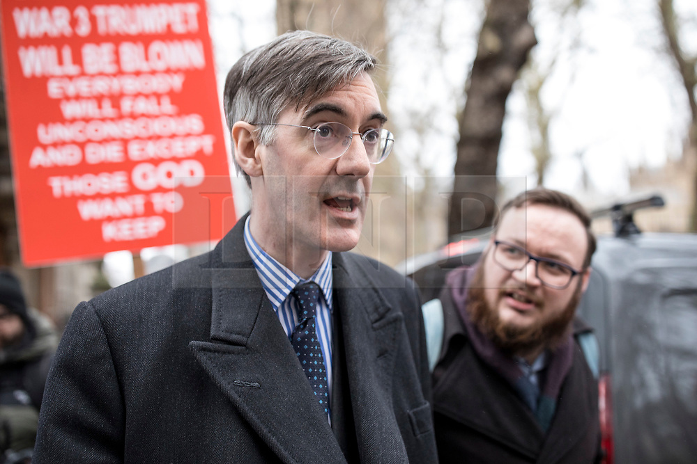 © Licensed to London News Pictures. 15/01/2019. London, UK. A People's Vote supporter asks Brexiteer Jacob Rees-Mogg about his position on the issue as he walks through Westminster. MPs will vote on Prime Minister Theresa May's Brexit deal this evening. Photo credit: Rob Pinney/LNP