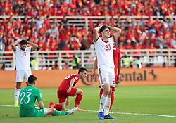ABU DHABI, Jan. 12, 2019  Iran's Sardar Azmoun (1st R) reacts during the 2019 AFC Asian Cup UAE 2019 group D match between Vietnam and Iran in Abu Dhabi, the United Arab Emirates (UAE), Jan. 12, 2019. Iran won 2-0. (Credit Image: © Xinhua via ZUMA Wire)