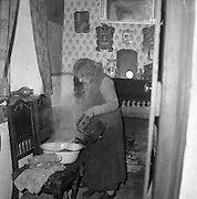 Limerick Widows Alms House. The oldest widow, Mrs. Bridgit Riordan (93),  prepares to do her washing in her room..28.03.1962