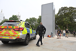 © Licensed to London News Pictures. 12/06/2020. London, UK. Armed police at a boarded up statue of Winston Churchill on Parliament Square, ahead of a Black Lives Matter demonstration In Parliament Square, central London. Black Lives Matter have called for the removal of statues from throughout the UK of historical characters involved in the slave trade, following the death of George Floyd in the U. S. A . Photo credit: Ben Cawthra/LNP