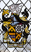 Stained glass window heraldic symbols and Coat of Arms, church of  Saint Mary, Friston, Suffolk, England, UK - En Dieu Est Tout