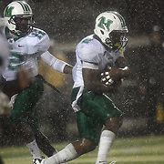Marshall quarterback Rakeem Cato (12) hand the football to Marshall running back Tron Martinez (2) in the rain during an NCAA football game between the Marshall Thundering Herd and the Central Florida Knights at Bright House Networks Stadium on Saturday, October 8, 2011 in Orlando, Florida. (Photo/Alex Menendez)