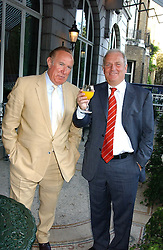 Left to right, ANDREW NEIL and KELVIN MACKENZIE at a party hosted by Andrew neil and The Business Newspaper held at The Ritz, Piccadilly, London on 12th July 2005.<br />