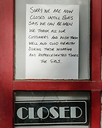 MERTHYR TYDFIL, WALES - 11 MAY 2020 - A sign in a local hair dressers explaining they are closed until Boris says they can re open.
