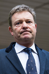 © Licensed to London News Pictures. 09/01/2019. London, UK.  Craig Mackinlay speaks to the press as he leave Southwark Crown Court after he was cleared of breaking electoral expenses rules in his 2015 general election campaign.  Photo credit: Vickie Flores/LNP