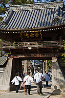 """The Shikoku Pilgrimage is a trail of 88 temples on the island of Shikoku. It is believed all 88 temples were visited by the famous Buddhist monk Kukai, founder of the Shingon school, who was born in Zentsuji Temple in 774.  To complete the pilgrimage, it is not necessary to visit the temples in order.  The pilgrimage is traditionally completed on foot, but modern pilgrims use cars, taxis, buses, bicycles or motorcycles. The walking course is approximately 1200km long and can take anywhere from 30 to 60 days to complete. """"Henro"""" is the Japanese word for pilgrim - they are recognizable by their white clothing, sedge hats, and walking sticks."""
