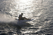 Man riding motorized kayak, Hawaii