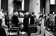 he State funeral of Kathleen Clarke, widow of executed 1916 leader Tom Clarke, in the Pro-Cathedral, Dublin. Kathleen Clarke was a founding member of Cumann na mBan, served as a senator 1928-36 and was the first female Lord mayor of Dublin 1939-43. Her brother, Ned Daly was also executed in 1916. Pictured passing the coffin are Minister for Justice, Des O'Malley and Minister for Labour, Joe Brennan. An Taoiseach, Mr Jack Lynch, is kneeling to the right. <br /> 03/10/1972