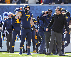 Nov 10, 2018; Morgantown, WV, USA; West Virginia Mountaineers quarterback Will Grier (7) celebrates with West Virginia Mountaineers offensive coordinator Jake Spavital after a touchdown during the second quarter against the TCU Horned Frogs at Mountaineer Field at Milan Puskar Stadium. Mandatory Credit: Ben Queen-USA TODAY Sports