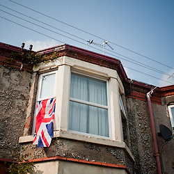 A flag hangs from a window in New Brighton.