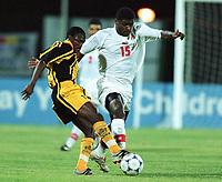 Fotball<br /> Afrikamesterskapet/African Nations Cup 2002<br /> Zambia v Tunisia<br /> Foto: Digitalsport<br /> NORWAY ONLY<br />  RADHI JAIDI (TUN) / GIFT KAMPAMBA (ZAM)