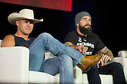 """LAS VEGAS, NV - JULY 10:  Donald """"Cowboy"""" Cerrone and CM Punk look on during UFC Fan Expo Day 3 at the Las Vegas Convention Center on July 10, 2016 in Las Vegas, Nevada. (Photo by Cooper Neill/Zuffa LLC/Zuffa LLC via Getty Images) *** Local Caption *** Donald """"Cowboy"""" Cerrone; CM Punk"""