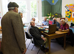 © Licensed to London News Pictures.04/08/15<br /> Egton, UK. <br /> <br /> <br /> Judges discuss one man's entry during the annual Egton Gooseberry Show. <br /> There are only two Gooseberry societies left in the country. One in Cheshire and one at Egton in North Yorkshire. The annual show in Egton uses traditional Avoridupois scales to measure the weight of the berries and members of the society are fanatical about trying to grow the best berries each year. <br /> <br /> Photo credit : Ian Forsyth/LNP