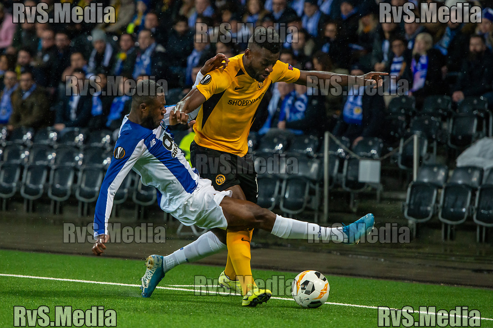 BERN, SWITZERLAND - NOVEMBER 28: #19 Chancel Mbemba of FC Porto battles for the ball with #18 Jean-Pierre Nsame of FC Porto during the UEFA Europa League group G match between BSC Young Boys and FC Porto at Stade de Suisse, Wankdorf on November 28, 2019 in Bern, Switzerland. (Photo by Monika Majer/RvS.Media)