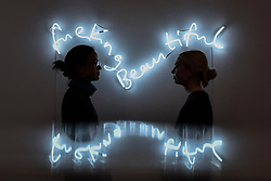 """© Licensed to London News Pictures. 12/10/2017. London, UK.  Staff members view """"fuckingbeautiful"""", 2013, by Tim Noble and Sue Webster (Est. GBP25-35k) at a preview of artworks for the """"Art for Grenfell"""" auction taking place at Sotheby's, New Bond Street, on 16 October.  Leading contemporary artists have agreed to donate works to the auction, the proceeds of which will be divided equally amongst the 158 surviving families of the Grenfell Tower fire by the Rugby Portobello Trust charity. Photo credit : Stephen Chung/LNP"""