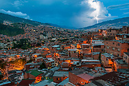 Dusk view of lightning storm seen from San Javier (also known as Comuna 13) in Medellin, Colombia.