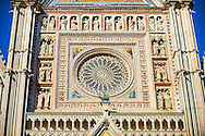 Close up of the rose window built by the sculptor and architect Orcagna between 1354 and 1380 on the14th century Tuscan Gothic style facade of the Cathedral of Orvieto, designed by Maitani, Umbria, Italy .<br /> <br /> Visit our ITALY HISTORIC PLACES PHOTO COLLECTION for more   photos of Italy to download or buy as prints https://funkystock.photoshelter.com/gallery-collection/2b-Pictures-Images-of-Italy-Photos-of-Italian-Historic-Landmark-Sites/C0000qxA2zGFjd_k<br /> .<br /> <br /> Visit our MEDIEVAL PHOTO COLLECTIONS for more   photos  to download or buy as prints https://funkystock.photoshelter.com/gallery-collection/Medieval-Middle-Ages-Historic-Places-Arcaeological-Sites-Pictures-Images-of/C0000B5ZA54_WD0s