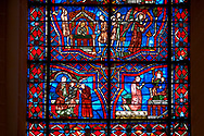 Medieval stained glass Window of the Gothic Cathedral of Chartres, France - dedicated to the Life of St Remigius (Remy).  A UNESCO World Heritage Site. .<br /> <br /> Visit our MEDIEVAL ART PHOTO COLLECTIONS for more   photos  to download or buy as prints https://funkystock.photoshelter.com/gallery-collection/Medieval-Middle-Ages-Art-Artefacts-Antiquities-Pictures-Images-of/C0000YpKXiAHnG2k