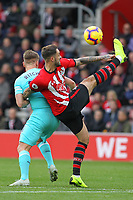 Football - 2018 / 2019 Premier League - Southampton vs. Newcastle United<br /> <br /> Southampton's Danny Ings controls a high ball from Matt Ritchie of Newcastle during the Premier League match at St Mary's Stadium Southampton  <br /> <br /> COLORSPORT/SHAUN BOGGUST