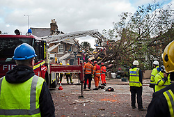© London News Pictures. 28/10/2013 . London, UK.  Wreckage of a house left after a gas explosion  caused by a falling tree in heavy wind in Housllow, West London, which hospitalising at least three people. Gusts of 99mph have been recorded as a storm continues to batter parts of England and Wales. Photo credit : Ben Cawthra/LNP