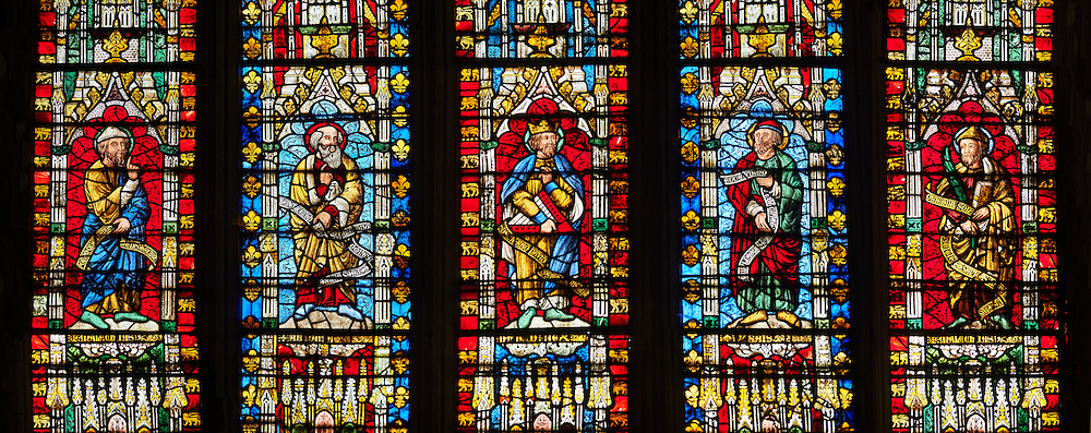 """Stained glass of the medieval Wells Cathedral built in the Early English Gothic style in 1175, Wells Somerset, England . Its Gothic architecture is mostly in Early English style of the late 12th – early 13th centuries. Building began about 1175 at the east end with the choir. Historian John Harvey sees it as Europe's first truly Gothic structure. Its Early English front with 300 sculpted figures, is seen as a """"supreme triumph of the combined plastic arts in England"""".<br /> <br /> Visit our MEDIEVAL PHOTO COLLECTIONS for more   photos  to download or buy as prints https://funkystock.photoshelter.com/gallery-collection/Medieval-Middle-Ages-Historic-Places-Arcaeological-Sites-Pictures-Images-of/C0000B5ZA54_WD0s"""