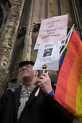 Canterbury 21/3/2013 - Homophobia campiagner protests againt Church policy as VIP guests from all religions, denominations and faiths arrive before the enthronement of the Church of England's 105th Archbishop of Canterbury, ex-oil executive and former Bishop of Durham the Right Reverend Justin Welby. Welby (57) follows a long Anglican heritage since Benedictine monk Augustine, the first Archbishop of Canterbury in 597AD Prince Charles and Prime Minister David Cameron joined 2,000 VIP guests to Canterbury Cathedral, the oldest church in England which has attracted pilgrims since Thomas a Becket was murdered in the Cathedral in 1170.
