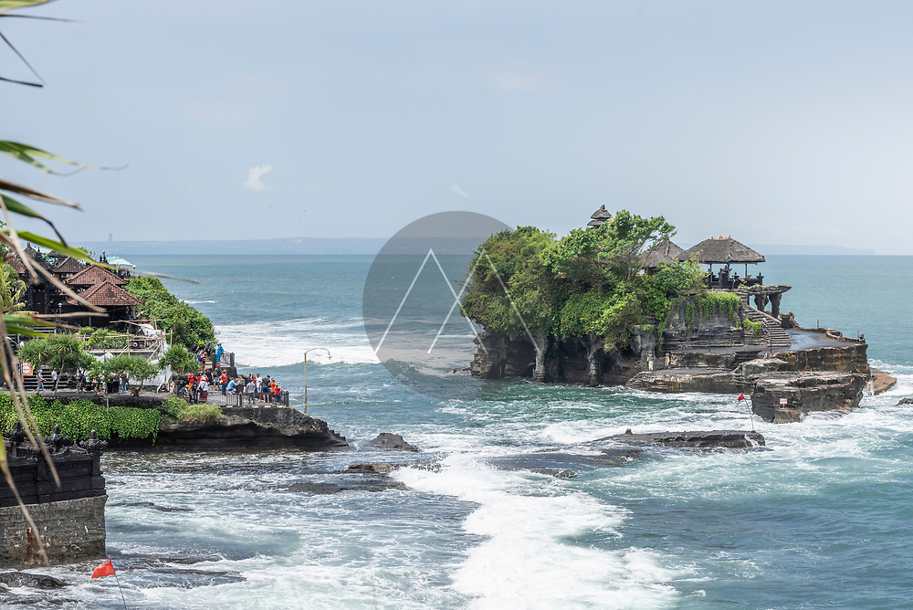 View of Tanah Lot temple along the bay, a buddhist complex on Bali island, Indonesia.
