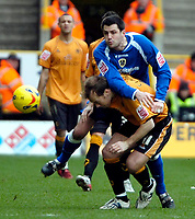 Photo: Ed Godden/Sportsbeat Images.<br />Wolverhampton Wanderers v Cardiff City. Coca Cola Championship. 20/01/2007. Wolves' Jamie Clapham, is approached from behind by Steven Thompson.