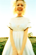 Woman in white laughing in motion blur