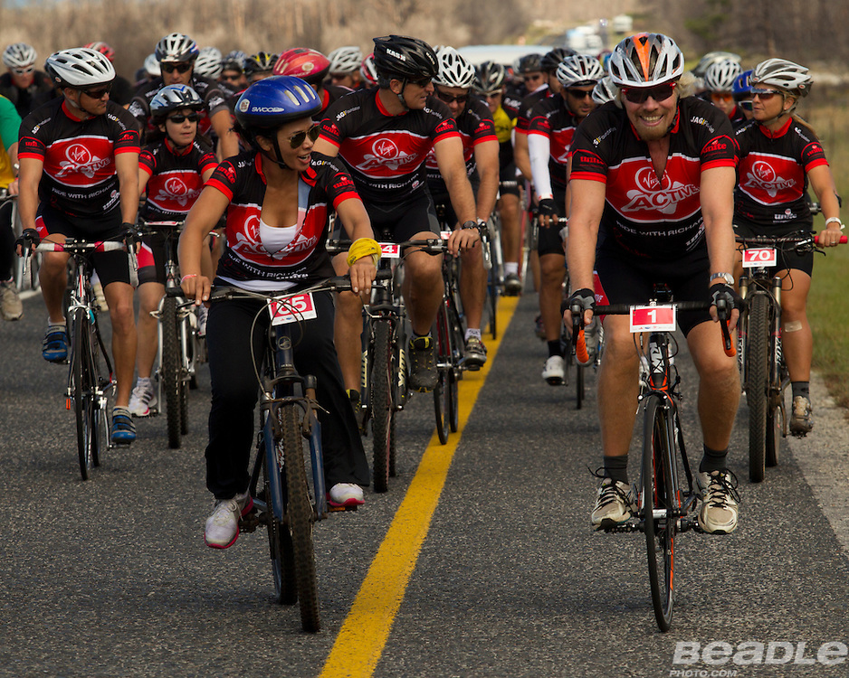 Sir Richard Branson joins a group of riders for a Virgin Unite fund-raiser cycle from Arabella hotel, Kleinmond, Western Cape. Image by Greg Beadle