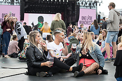 © Licensed to London News Pictures . 04/06/2017 . Manchester , UK . The crowd gathers in front of the stage . The One Love Manchester benefit concert for victims of the Manchester Arena terrorist attack , at the Emirates Old Trafford Cricket Stadium . Ariana Grande, Justin Bieber, Coldplay, Katy Perry, Miley Cyrus, Pharrell Williams, Usher, Take That, Robbie Williams, Black Eyed Peas and Niall Horan are amongst the performers . Photo credit : Joel Goodman/LNP