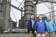 SHOT 10/29/18 9:45:59 AM - Sunrise Cooperative is a leading agricultural and energy cooperative based in Fremont, Ohio with members spanning from the Ohio River to Lake Erie. Sunrise is 100-percent farmer-owned and was formed through the merger of Trupointe Cooperative and Sunrise Cooperative on September 1, 2016. Photographed at the Clyde, Ohio grain elevator was George D. Secor President / CEO and John Lowry<br /> Chairman of the Board of Directors with  CoBank RM Gary Weidenborner. (Photo by Marc Piscotty © 2018)