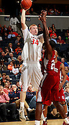 CHARLOTTESVILLE, VA- NOVEMBER 13:  James Johnson #34 of the Virginia Cavaliers shoots over Aaron Martin #23 of the South Carolina State Bulldogs during the game on November 13, 2011 at the John Paul Jones Arena in Charlottesville, Virginia. Virginia defeated South Carolina State 75-38. (Photo by Andrew Shurtleff/Getty Images) *** Local Caption *** James Johnson;Aaron Martin