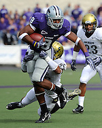 MANHATTAN, KS - OCTOBER 24:  Running back Daniel Thomas #8 of the Kansas State Wildcats rushes up field against pressure from safety Ray Polk #26 of the Colorado Buffaloes on October 24, 2009 at Bill Snyder Family Stadium in Manhattan, Kansas.  (Photo by Peter G. Aiken/Getty Images)