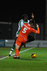 Blackpool's Gary MacKenzie is sent off for this challenge after receiving a second yellow card - Photo mandatory by-line: Dougie Allward/JMP - Tel: Mobile: 07966 386802 03/12/2013 - SPORT - Football - Yeovil - Huish Park - Yeovil Town v Blackpool - Sky Bet Championship