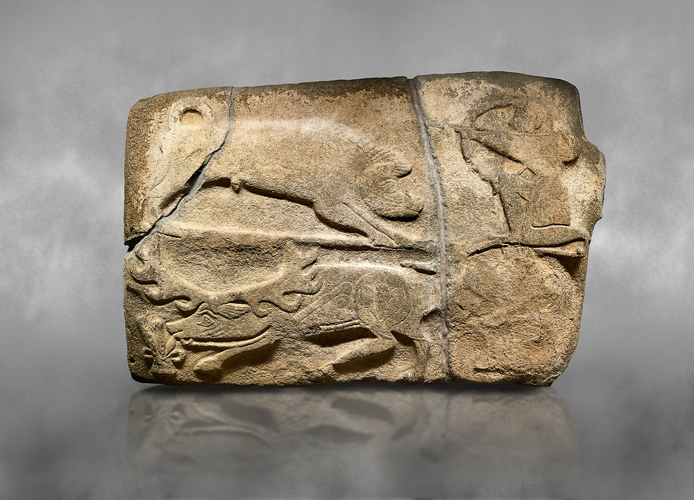 Alaca Hoyuk Hittite monumental relief sculpted orthostat stone panel of a hunt.  Anatolian Civilizations Museum. Ankara. Turkey.<br /> <br /> A kneeling figure on the top right is shooting arrows from a bow at a wild boar. Below them deer are grazing. Another hunter is in the bottom right of the panel but has been badly weathered.<br /> <br /> Against a grey art background. .<br />  <br /> If you prefer to buy from our ALAMY STOCK LIBRARY page at https://www.alamy.com/portfolio/paul-williams-funkystock/hittite-art-antiquities.html . Type - Aalca Hoyuk - in LOWER SEARCH WITHIN GALLERY box. Refine search by adding background colour, place, museum etc.<br /> <br /> Visit our HITTITE PHOTO COLLECTIONS for more photos to download or buy as wall art prints https://funkystock.photoshelter.com/gallery-collection/The-Hittites-Art-Artefacts-Antiquities-Historic-Sites-Pictures-Images-of/C0000NUBSMhSc3Oo