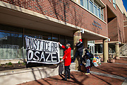 Protesters hang a banner at the municipal building in State College, Pennsylvania on March 19, 2021. The 3/20 Coalition organized a protest and march to mark the second anniversary of Osaze Osagie being shot and killed by State College police at his apartment. (Photo by Paul Weaver)