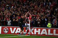 Gareth Bale of Wales celebrates with the Wales fans after he scores his teams 3rd goal. Wales v Moldova , FIFA World Cup qualifier at the Cardiff city Stadium in Cardiff on Monday 5th Sept 2016. pic by Andrew Orchard, Andrew Orchard sports photography
