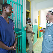 CAPTION: The Canadian doctors and nurses make a point of fostering a friendly atmosphere, as they are keen not to be perceived as having come to impose their ideas on them. LOCATION: Hôpital Universitaire Justinien, Cap-Haïtien, Haiti. INDIVIDUAL(S) PHOTOGRAPHED: From left to right: Charles Lafontant, Dr Emile Damas and Roger Paul Delorme.