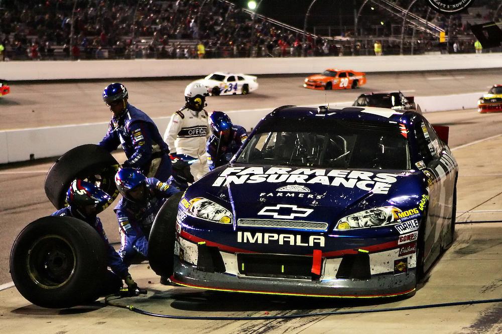 Apr 28, 2012; Richmond, VA, USA; NASCAR Sprint Cup driver Kasey Kahne (5) makes a pit stop during the Capital City 400 at Richmond International Raceway. Mandatory Credit: Peter Casey-US PRESSWIRE.