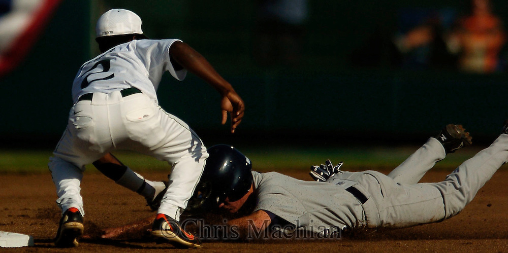 06/19/2006 Miami's Jemile Weeks tags Rice University's Brian Friday attempting to steal second to end the first inning during game eight of the College World Series in Omaha Nebraska Monday evening..(photo by Chris Machian/Prairie Pixel Group)