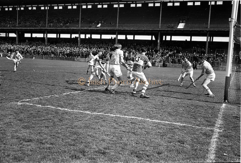 05/04/1964<br /> 04/05/1964<br /> 5 April 1964<br /> National Hurling League Semi-Final: Laoghis v Antrim at Croke Park, Dublin.<br /> Early in the game, Laoghis' C. O'Brien (left) strikes the ball to score his sides goal. Players include: Fitzpatrick (Laoghis), Gallagher (Antrim), and O'Reilly (Antrim).