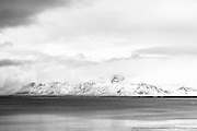 The iconic Esja, viewed from Reykjavík across Faxaflói bay, emerges from the clouds