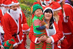 Over 1600 Santa's take part in Scotland's fundraising Santa's run, walk and stroll around Edinburgh's West Prices Street Gardens, raising money to grant the Wishes of Children for When You Wish Upon A Star. Sunday 11th December 2016. (c) Brian Anderson | Edinburgh Elite media