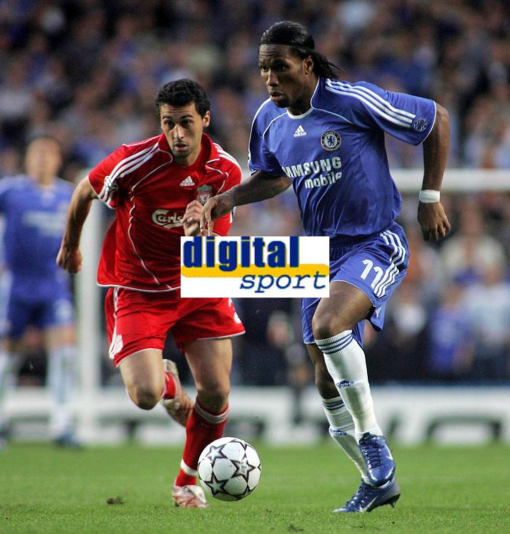 Photo: Paul Thomas.<br /> Chelsea v Liverpool. UEFA Champions League. Semi Final, 1st Leg. 25/04/2007.<br /> <br /> Didier Drogba (R) of Chelsea gets past Alvaro Arbeloa.