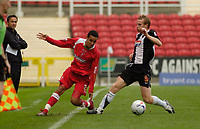 Photo: Leigh Quinnell.<br /> Swindon Town v Grimsby Town. Coca Cola League 2. 14/10/2006. Swindons Curtis Weston battles with Grimsbys Paul Bolland.