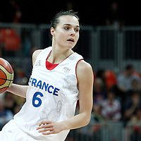 30 July 2012: Clemence Beikes of France looks to pass the ball during the 74-70 Team France overtime victory over Team Australia, during the women's basketball preliminary, at the Basketball Arena, in London, Great Britain.
