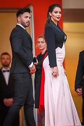 """Thomas Vergara and A pregnant Nabilla Benattia attend the screening of """"A Hidden Life (Une Vie Cachée)"""" during the 72nd annual Cannes Film Festival on May 19, 2019 in Cannes, France. Photo by Shootpix/ABACAPRESS.COM"""